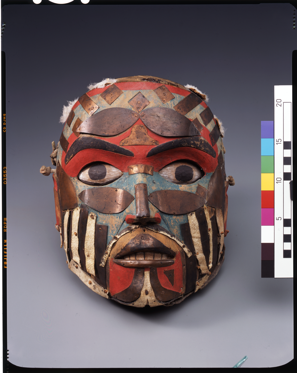 Large painted mask with strips of leather and copper