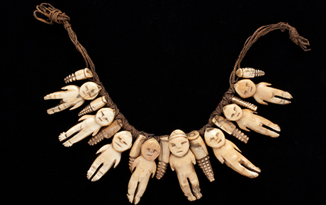 Necklace of eight ivory figures, interspersed with smaller decorative 'teeth' type figures.