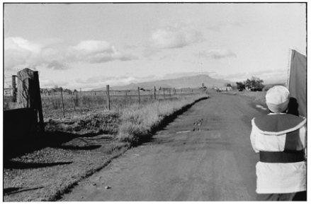Black and white photo of a road and a person