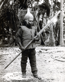 A black and white photo of a man wearing armour from Kiribati