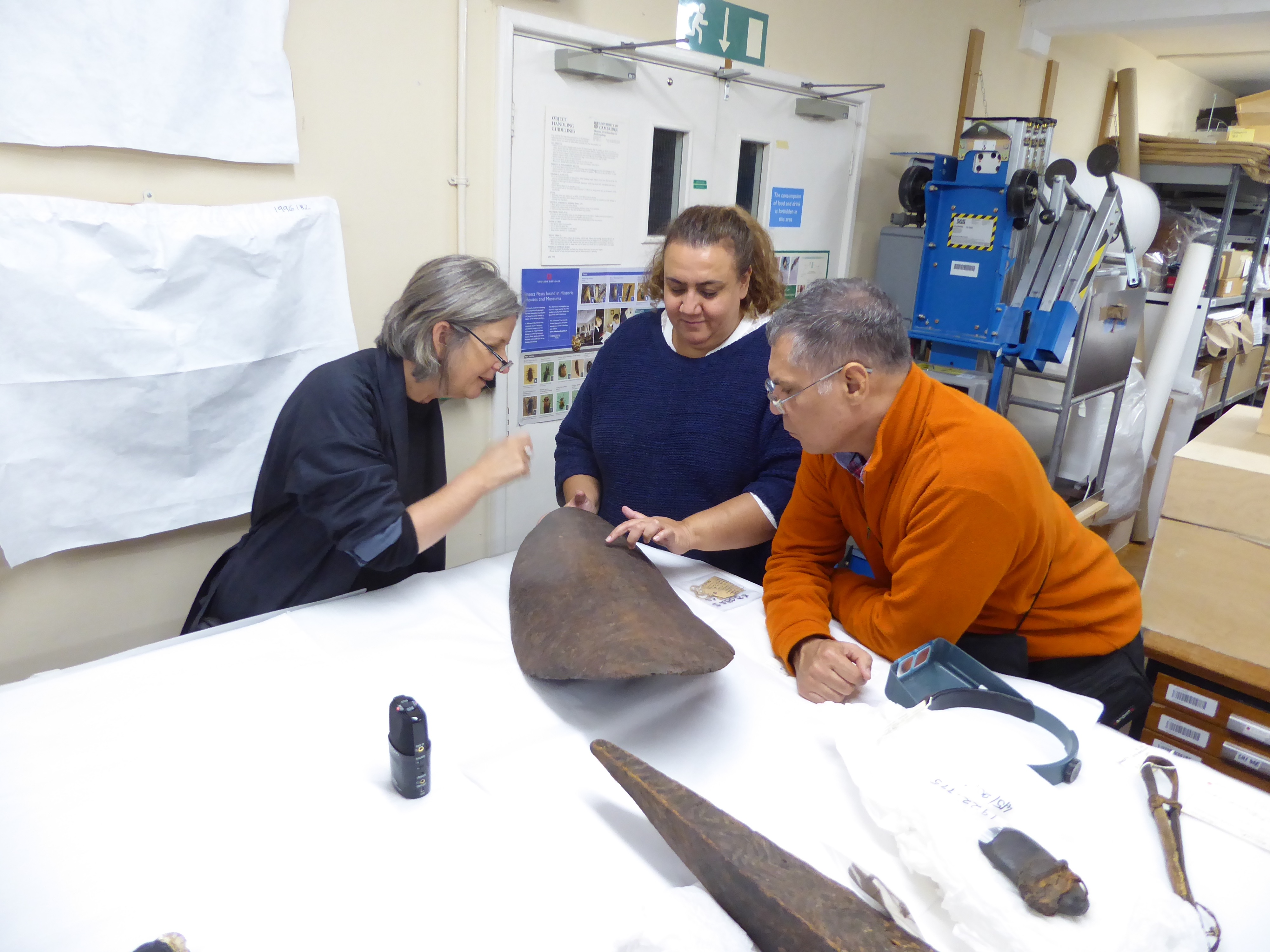 Dr Maria Nugent (Australian National University), Noeleen Timbery (Chair, La Perouse Local Area Land Council) and Dr Shayne Williams (Gweagal elder) examining early Sydney-region artefacts