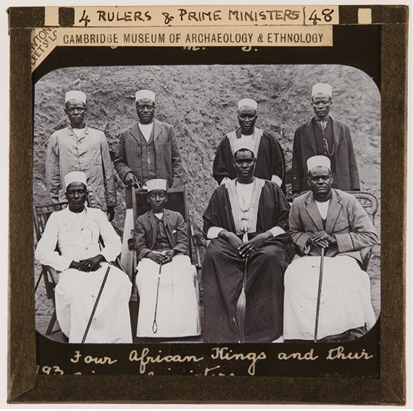 Sepia photograph with eight men, four sitting and four standing, within a paper frame. Wording: 'Rulers & Prime Ministers'. 'Cambridge Museum of Archaeology and Ethnology'