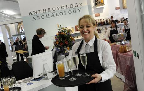 A staff member serves drinks