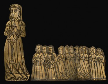 A medieval funerary monument of a lady with her four sons and eight daughters from Aldenham, Hertfordshire.