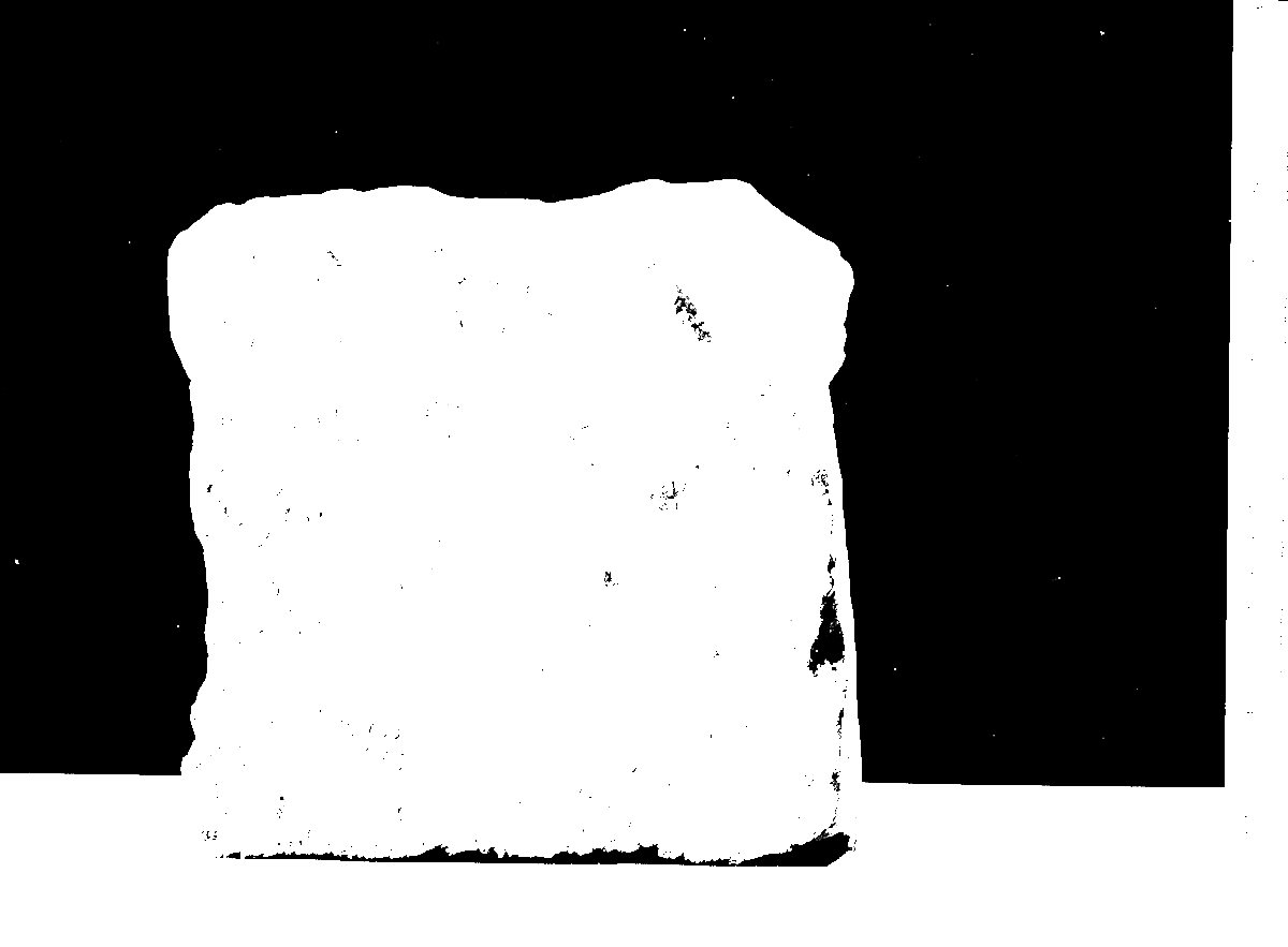 Piece of clunch on which is engraved about half the head of an Early Decorated six light window.