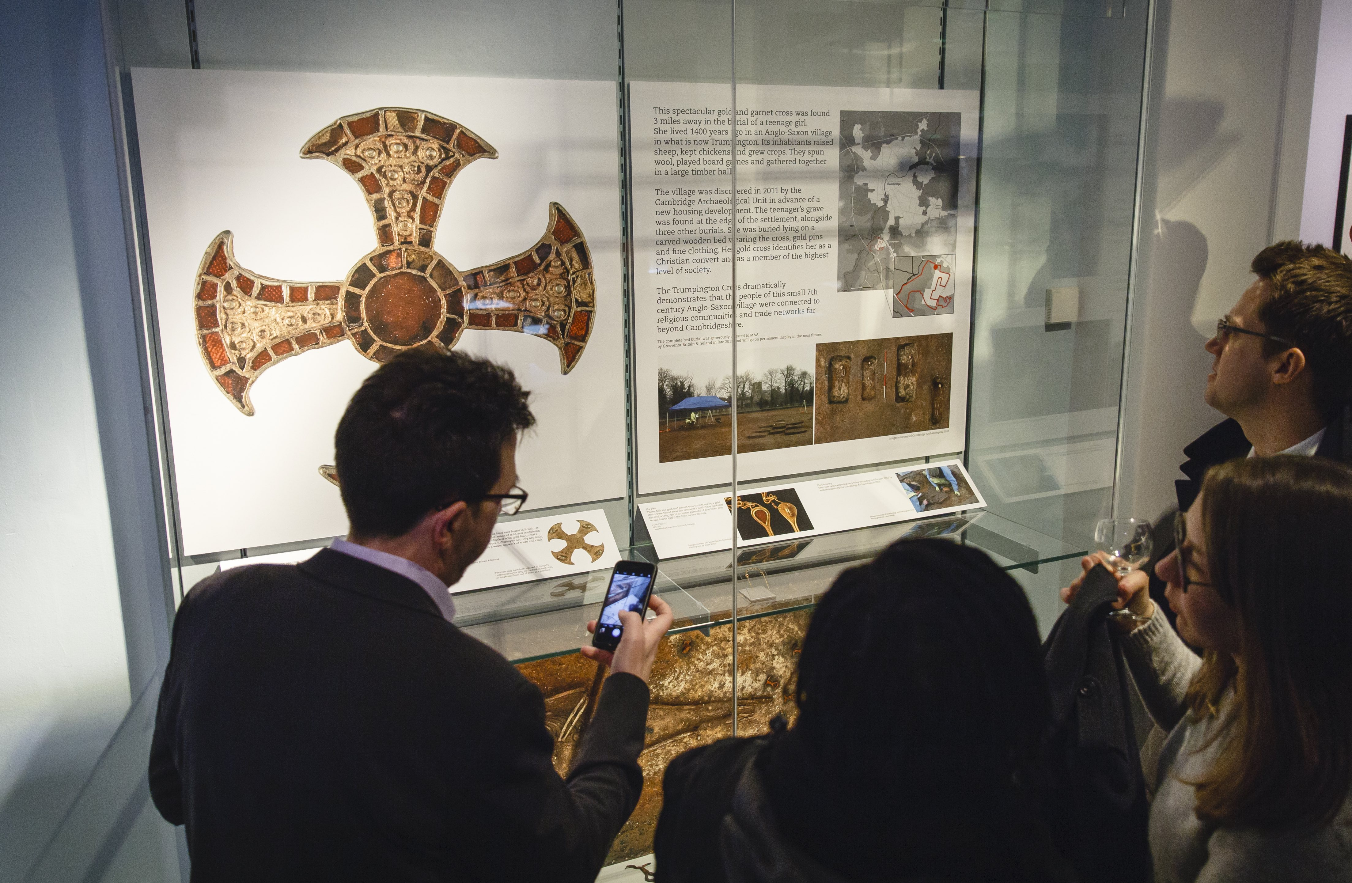 Visitors look at items in the Clarke Gallery