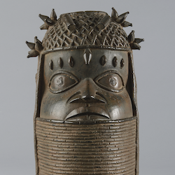 Lost-wax cast commemorative head of an Oba, used to support a tusk on an ancestral altar