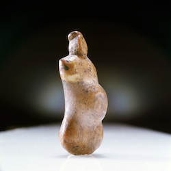 Small, ivory pendant in the form of a pregnant woman, from Ryder Island, Arctic