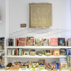 Colour photograph of books on a bookshelf in the MAA shop