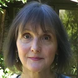 A colour photograph of Anita Herle, Curator of Anthropology at MAA