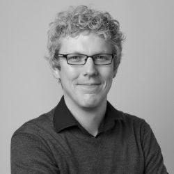 Black and white photograph of Mark Elliott, Curator of Anthropology, MAA