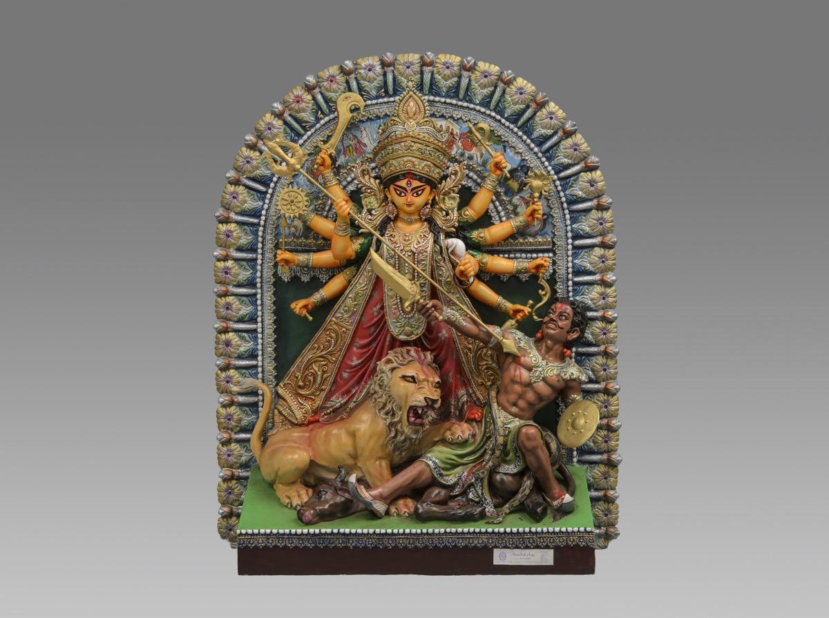 Fibre glass pratima (idol) of the Hindu goddess Durga slaying Mahisha, made by Mintu Paul.